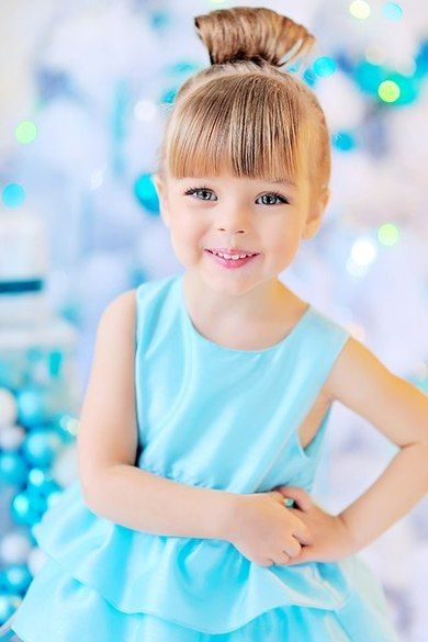 Pretty little girl in turquoise