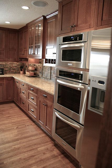 Stainless Steel Ovens, Microwaves, & Refrigerators...Oh My! by Steve Kuhl, via Flickr  LOVE THIS KITCHEN!  GORGEOUS!