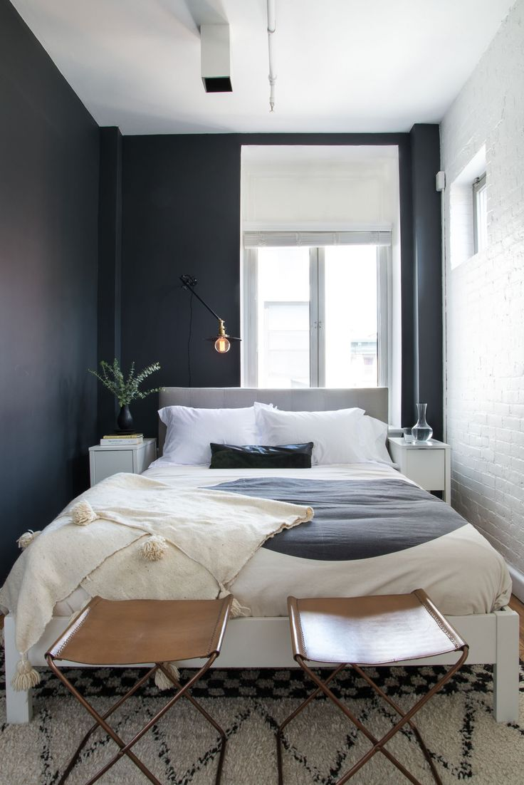 Dark Walls against a light bedding makes perfection. Also, can we talk about how amazing those stools are?