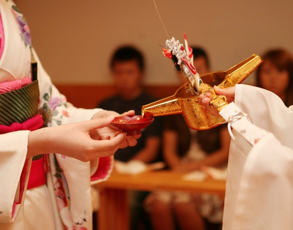 SANSANKUDO  -Exchange of nuptial cups is one of the ritual of japanese wedding vows .