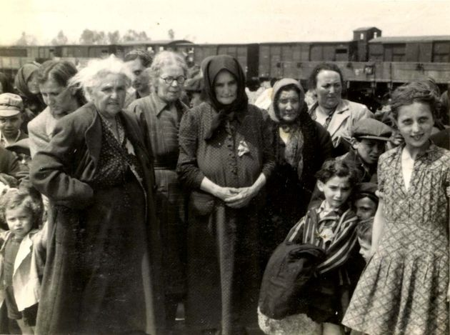Birkenau, Poland, Women and children standing on the selection platform, 05/1944.