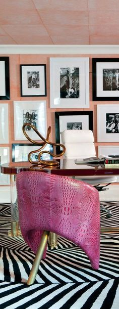 Contemporary Office Decor ideas by Kelly Wearstler Raspberry leather chairs by designer Kelly Wearstler bring color to a Bel Air, California, office, where a collection of photos is displayed; the tube sculpture on the desk is also by Wearstler, and the carpet was custom made by the Rug Company .