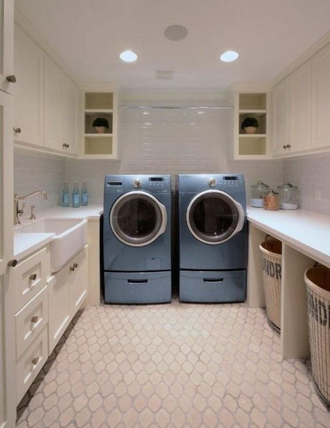 Nice U Shaped Laundry Room Has Ivory Cabinets With White Quartz Countertops And  Subway Tiled Backsplash Atop An Arabesque Tile Floor. Over The Blue  Front Load ...