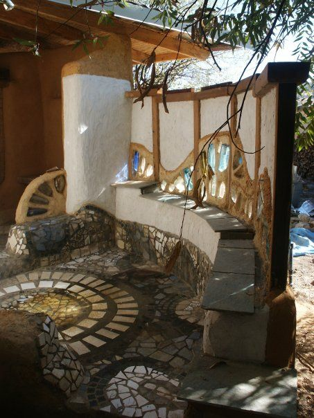 earthbag and cob bathhouse. Don't know that I would want a bathhouse, but I love those walls and the floor!