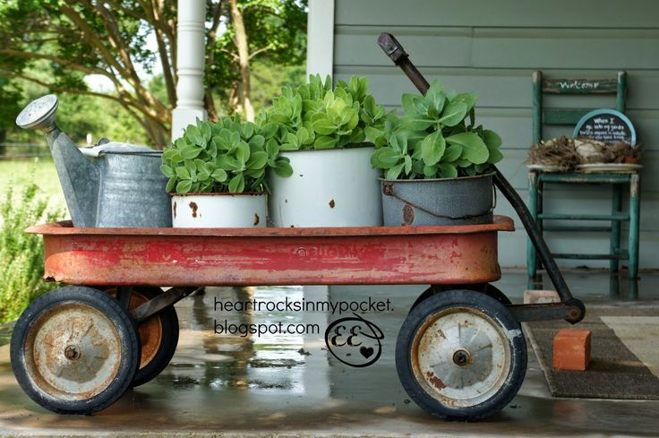 Radio Flyer Wagon on the Front Porch filled with enamel ware and galvanized containers - Heart Rocks in my Pocket