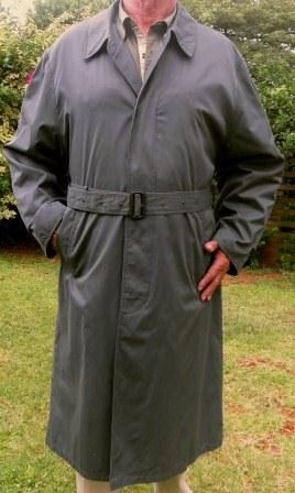 A light all weather trench coat from EB Company with two pockets, a back flap, a belt, a back vent, hidden pockets and two inside pockets. Stunning finishes, fine detail with a full lining plus a zipped in fully removable fleece inner lining that has quilted sleeves to turn a winter coat into an elegant summer one. A soft cotton and polyester fabric in gunmetal gray. In mint condition.