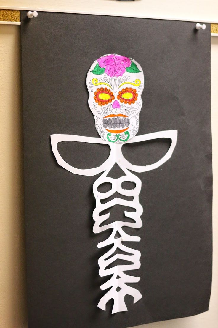 Making Day of the Dead skeletons out of writing students name in cursive!