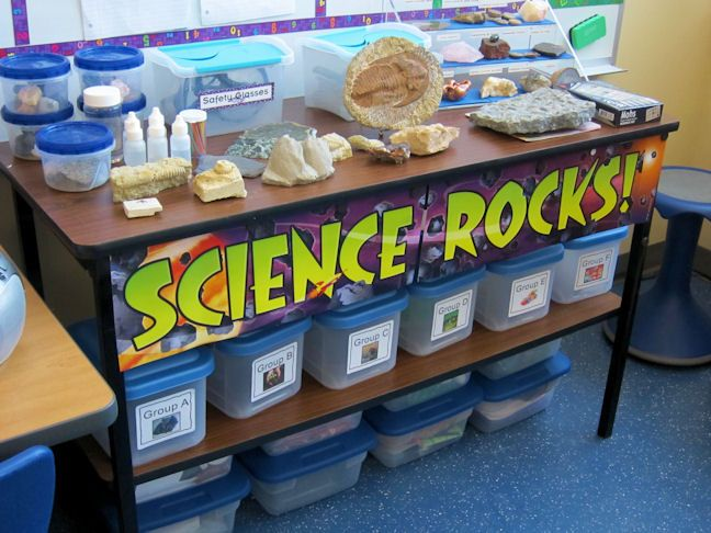 "have a science area with tubs or containers for each unit or theme. have clever title as well, just like this ""Science Rocks"" one"