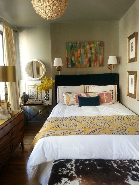 small bedroom in an NYC apartment.  Apartment Therapy Bedroom Retreat contest.  Gold wall sconces, wallpaper, upholstered headboard, abstract art above the bed, campaign table.
