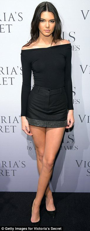 The model wore an off-the-shoulder top, studded mini-skirt and pumps all in black