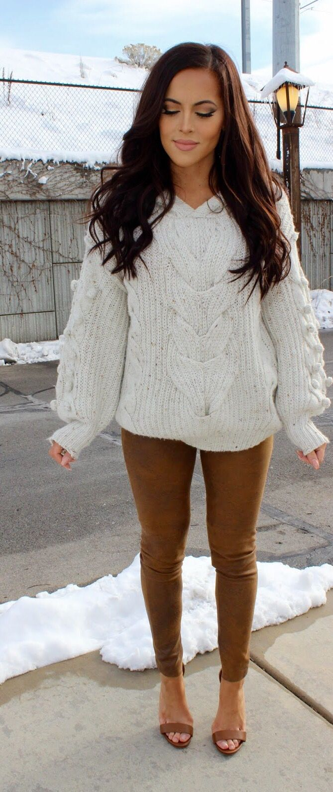 Neutrals: cream cable knit sweater and brown faux leather pants/leggings. Love this simple comfy outfit look. Dark brown hair with messy wsves.