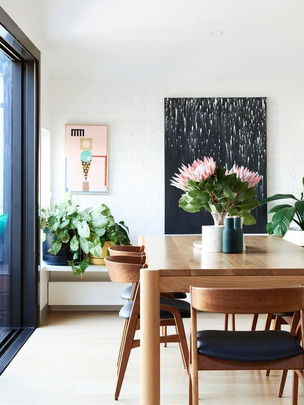 Gorgeous Earthy Dining Room With Cool Art And Mod Vibe
