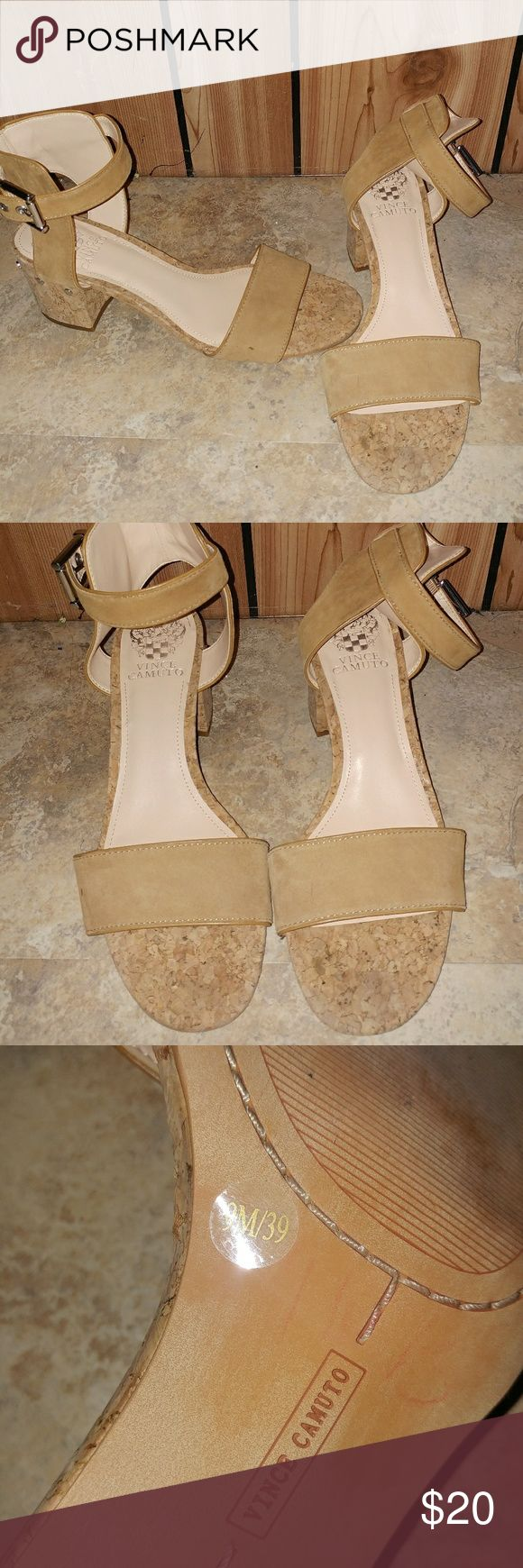 Vince Camuto Strappy Heeled Sandals This is a pair of camel colored Strappy sandals by Vince Camuto. Super cute and comfortable. Have some wear that can be seen on the bottoms. Have some cool silver detailing on the sides. The straps are adjustable. Vince Camuto Shoes Sandals