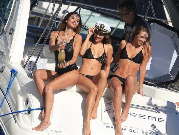 Model CJ Franco, Danielle Lombard, and Shannon Waterman model bikinis while sipping on Champagne and 138 Water during a photoshoot with Daren Cornell and Stephen Garnett for an Arsenic TV snapchat Takeover with Uniq Yacht in marina Del Rey, CA on April 23, 2017.