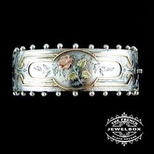 Victorian sterling silver cuff with shotted edge, rose gold and green gold applied detail.