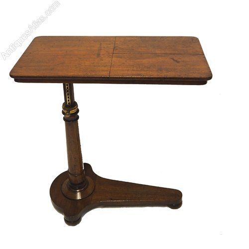 Fine quality early Victorian mahogany adjustable (bed) reading table in very good condition. Nice shape base with turned column with top quality engraved brass decoration to the top ring. The table top with two fully adjustable reading up stands. The whole table top is also fully adjustable via the