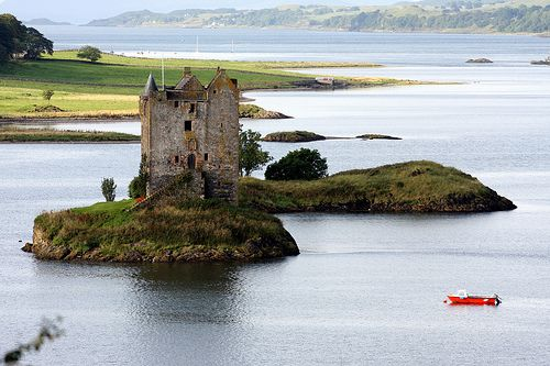 "Castle Stalker, Scotland ~ on tiny island in western Scotland. Few castles look lonelier than Castle Stalker at high tide. Castle Stalker — pronounced ""stall-ker"" — sits on what is usually a tiny island in western Scotland, although at low tide the water recedes enough that you might be able to wade over from the mainland. Castle Stalker may be one of the most-seen in the world, at least on screen: The 14th-century castle starred in ""Monty Python and the Holy Grail,"" appearing in the final sc...Orange Boats, Dreams, Castles Stalker, Pin Stuff, Stalker Overlooking, Tiny Castles, Tiny Orange, Things Orange, Stalker Host"
