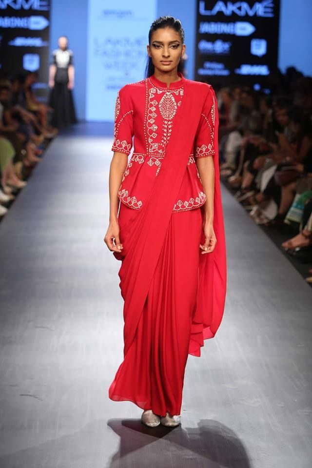 A unique look with red #saree draped over a short #kurti am:pm by Ankur & Priyanka Modi at Lakme Fashion Week