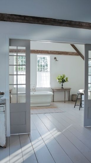 new england cottage interior design | ... interiors. An antique barn door leads from the main house to the