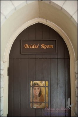 The bride peeks out of the window of the dressing room door at the Episcopal Church of the Good Shepherd in Austin, Texas.