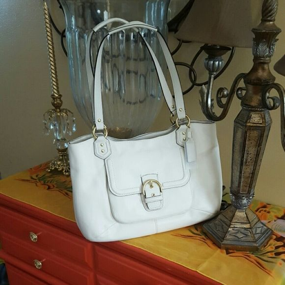 NWOT Authentic White Coach Purse Campbell Leather Belle Carryall - Ivory. Brand new - Tags are missing. There is a slight gray mark on one of the shoulder straps and that has been taken into account in the price. NO LOWBALL OFFERS - THEY WILL BE IGNORED! Coach Bags Shoulder Bags