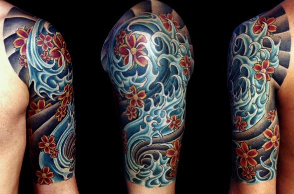 Amazing cherry blossom & ocean water tattoo from Black Lotus Tattooers in Gilbert, AZ