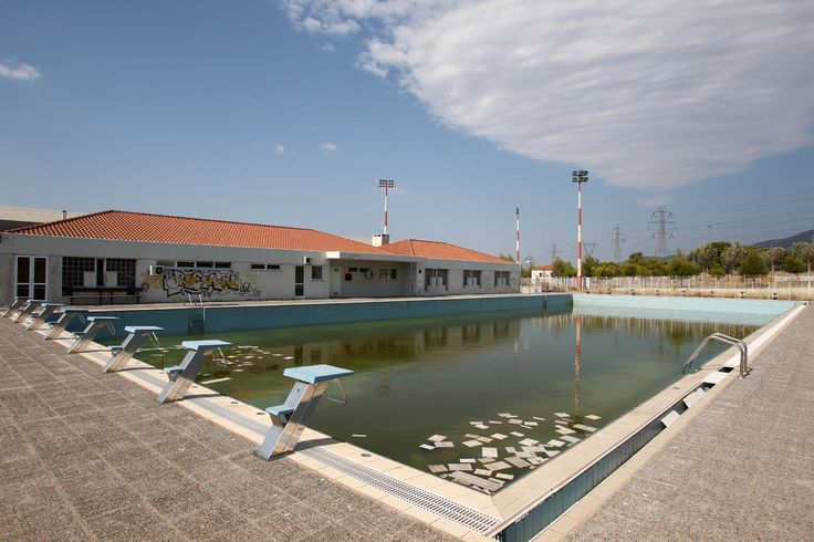 Murky water and rubbish fill an abandoned training pool for athletes at the 2004 Olympic village on the northern fringes of Athens.