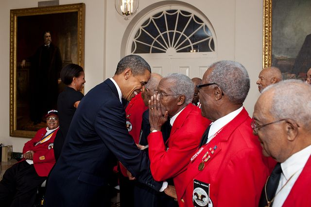 "President Barack Obama and First Lady Michelle Obama greet Tuskeegee Airmen in the East Garden Room of the White House prior to a screening of the film ""Red Tails"" in the Family Theater, Jan. 13, 2012."