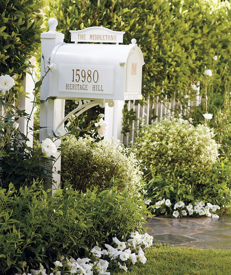 A Beautiful First Impression | Frontgate Blog Who doesn't love a white picket fence and a great mailbox!