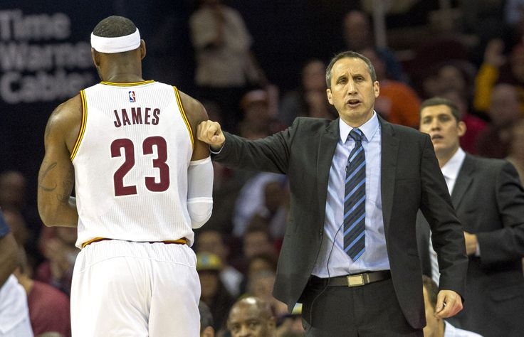 Cleveland Cavaliers head coach David Blatt greets LeBron James during an exhibition game against the... - Jason Miller/Getty Images