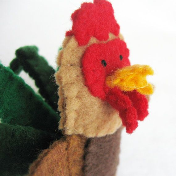 Made from felt, this finger puppet is about 2.5 inches tall. Each piece is hand cut and hand sewn together one tiny stitch at a time. Attention to detail is given to both the front and the back. No glue or beads are used.