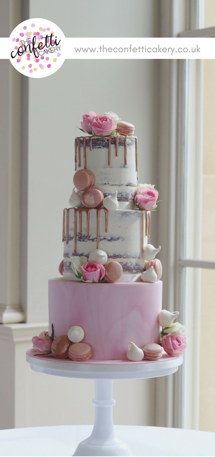 Modern wedding cake with semi-naked tiers and marbled sugar paste. Decorated with rose gold drips, macarons, meringues and roses. Cake & Image: The Confetti Cakery. #modernweddingcakes #goldweddingcakes #weddingcakes