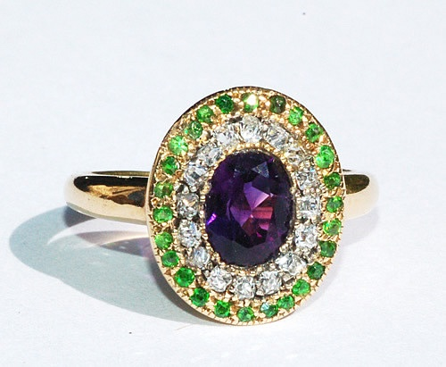 Ring in the Suffragette Colours, c.1910.  Give Women Votes (Green, White, Violet)  Green: Hope  White: Purity  Purple: Dignity