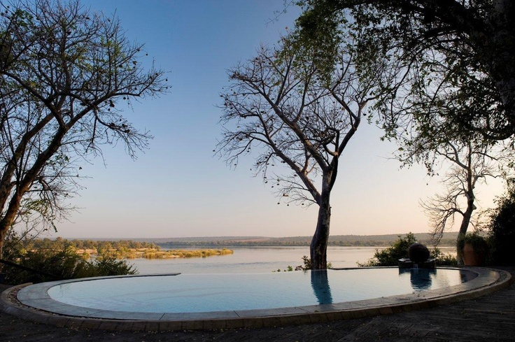 The pool at The River Club on Zambia's Zambezi River seems part of the river itself, while a secluded deck provides respite - beauty treatments are available in the Wellness Centre.