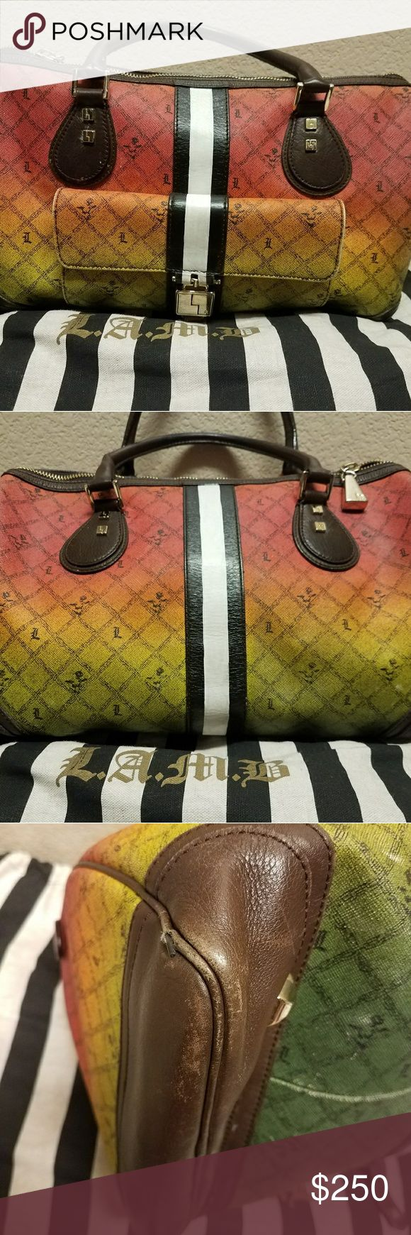 L.a.m.b gwen stefani rasta alston Lamb gwen stefani large rasta alston satchel. Good used condition. One edge has piping showing as pictured. Smoke free home. Bought and never used, needs a good home. L.A.M.B. Bags