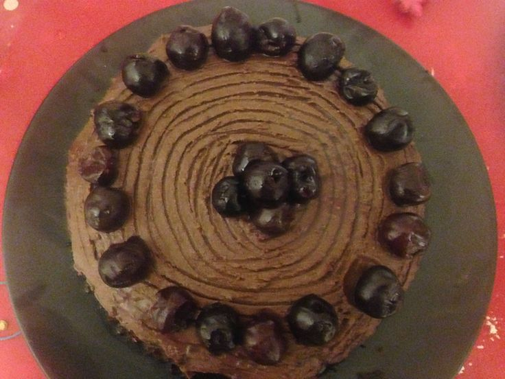 The birthday cake is finished! Chocolate sponge, chocolate ganache and Cointreau-soaked cherries.