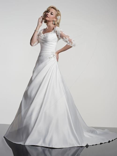 Balletts Bridal - 20556 - Wedding Gown by Jacquelin Bridals Canada - Satin 3/4 Illusion Lace Sleeve. Satin A-line Side Gather gown. Lower Scoop Neckline. Beaded Hip Detail Lace-up Back. Semi Catherdral train.