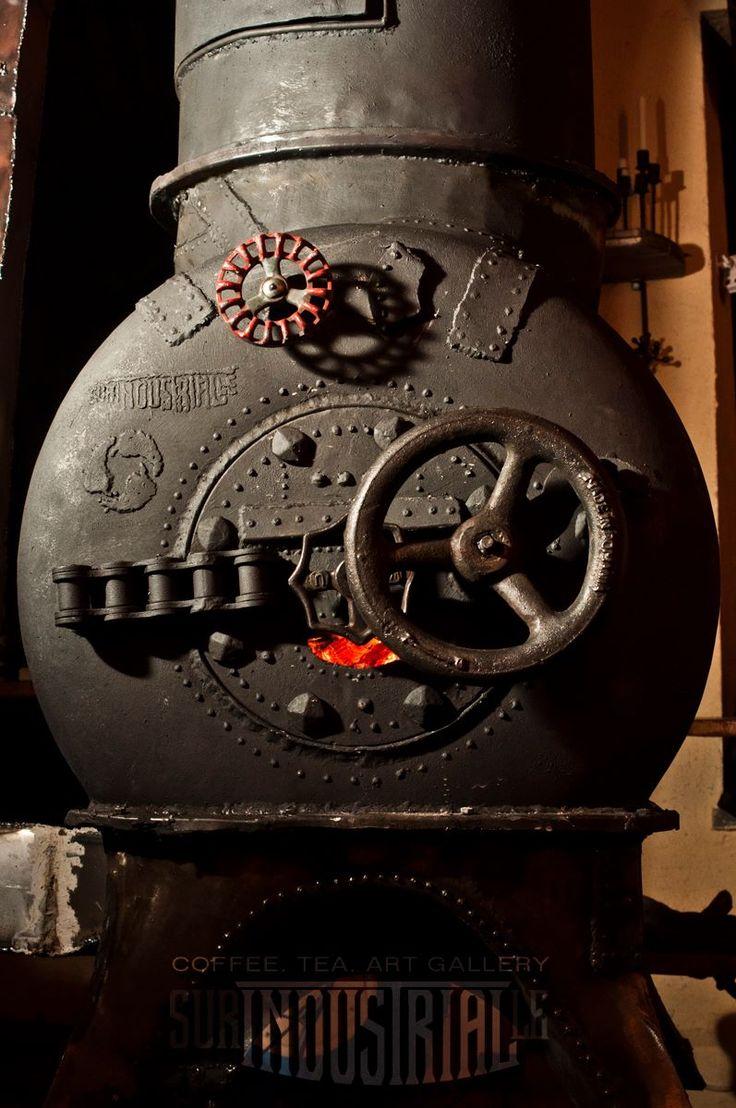 Metal rocket heater welded from scrap. Surindustrialle Gallery in Lodz / Poland. Scrap metal art, welding applied art and jewellery
