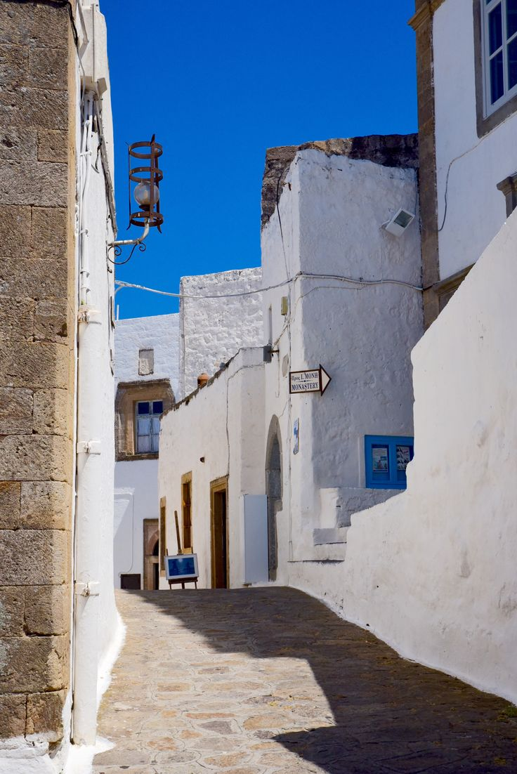 The UNESCO listed island of Patmos in Greece. One of the most beuatiful Greek islands. Find out more on vagrantsoftheworld.com