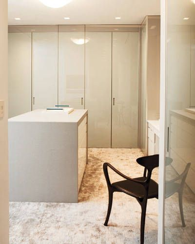 """Jennifer Post, designer: """"You don't need a dresser if your closet has an island. I divide an island into his and hers sections, with drawers for underwear, T-shirts, socks, gym clothes, and lingerie. My favorite system is by Poliform. It's top quality, luxuriously minimalist, and they'll customize anything."""" Senzafine, left; poliformusa.com.   - ELLEDecor.com"""