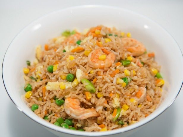INGREDIENTS  1/4 cup canola oil 8 ounces medium shrimp, peeled and deveined 3 eggs, lightly beaten 2 teaspoons grated ginger 2 teaspoons minced garlic 1 bunch scallions, white and light green parts only, thinly sliced 5 cups cooked white rice 2 cups frozen vegetable medley ( peas, carrots and corn), thawed 1/4 cup soy sauce