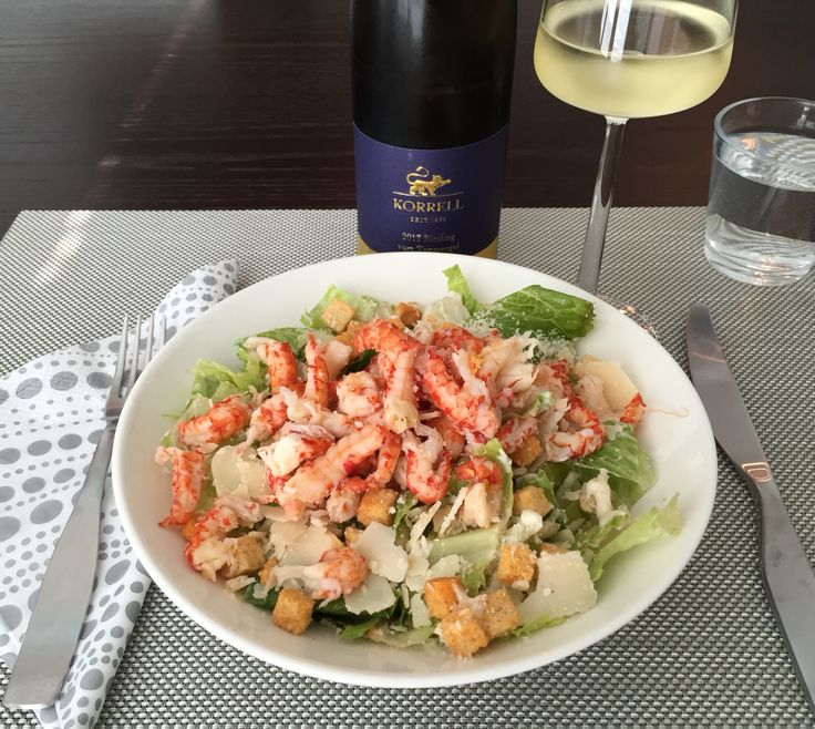 Shrimp caesar salad with riesling wine