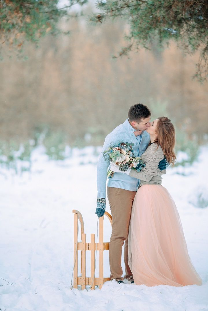 Light blue and peach wedding colours for Outdoor Winter Wedding in the snow