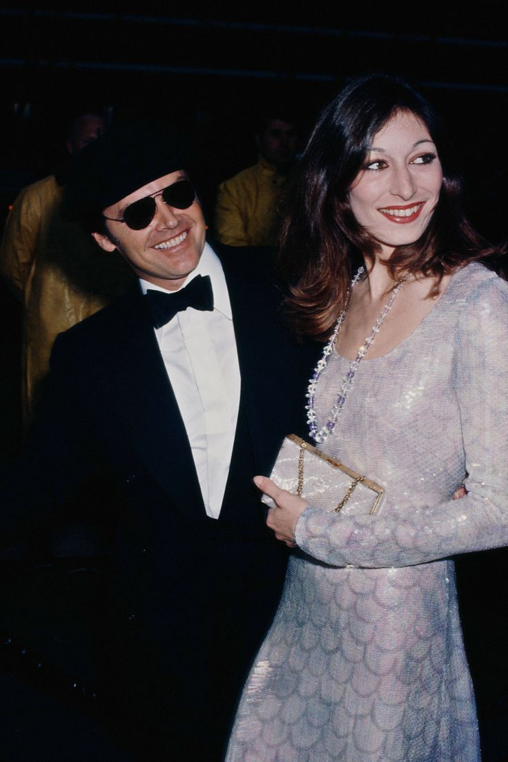 Anjelica Huston in Halston, 1975Halston and the 1975 Oscars made for quite the match. Anjelica Huston—on the arm of Jack Nicholson—seemed like a modern-day mermaid in a fish scale–patterned iridescent number by the designer, while Lauren Hutton paired a pastel-hued gown with a fur chubby and bare, bronzed skin—two looks that proved glamour and ease can, in fact, go hand in hand.—Zoe Ruffner, Vogue Associate Beauty Editor