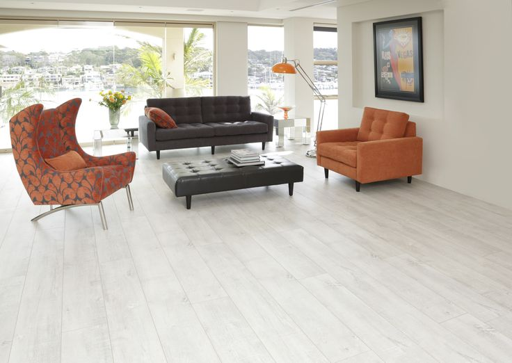Classica XXL Laminate Flooring - Glacier White. Extra wide and long plank for quick and easy installation.