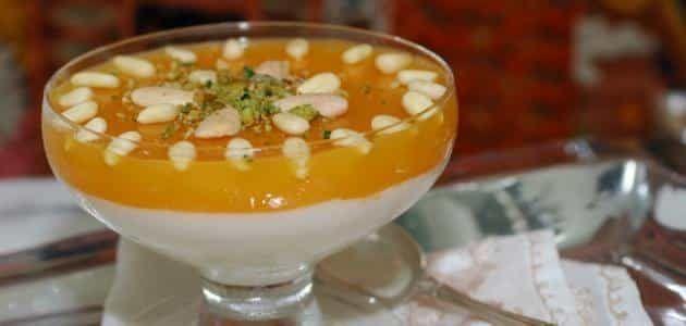 طريقة عمل مهلبية قمر الدين بالحليب المكثف والبندق Ramadan Desserts Middle Eastern Food Desserts Orange Recipes Dessert