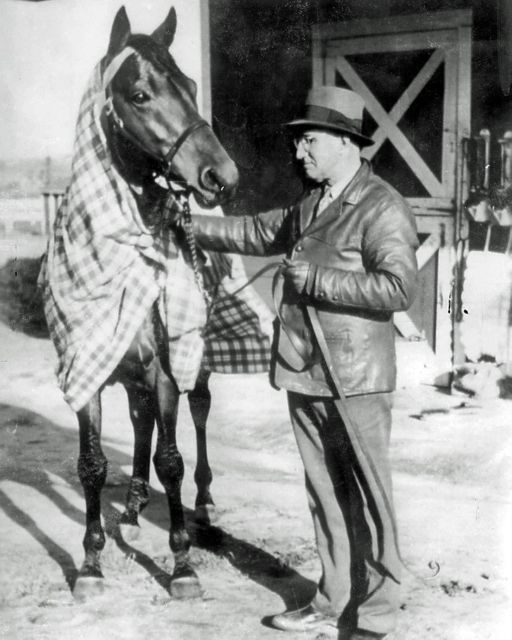 Seabiscuit - Very rare 1939 photo of champion Seabiscuit with trainer Tom Smith. Seabiscuit was ranked 25th top racehorse of the 20th Century.