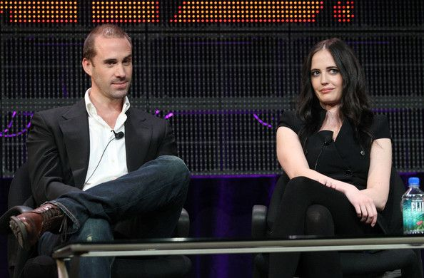 Eva Green Photos Photos - Actors Joseph Fiennes (L) and Eva Green speak during the 'Camelot' panel at the Starz portion of the 2011 Winter TCA press tour held at the Langham Hotel on January 7, 2011 in Pasadena, California. - 2011 Winter TCA Tour - Day 3