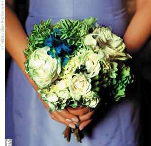 The Bridesmaid Bouquets    The maids' bouquets featured a variety of white, green, and blue flowers including roses, hydrangeas, sweet pea, tweedia, green berries, Snow-on-the-Mountain, and blue delphinium.