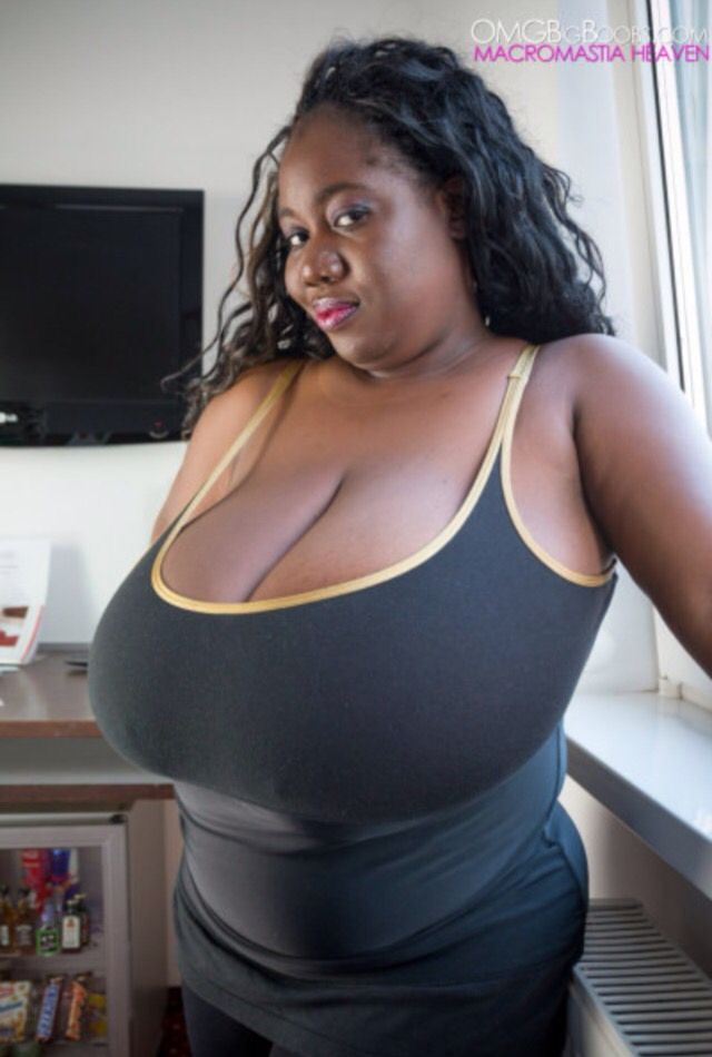 Ebony Woman With Large Naturals In This 97